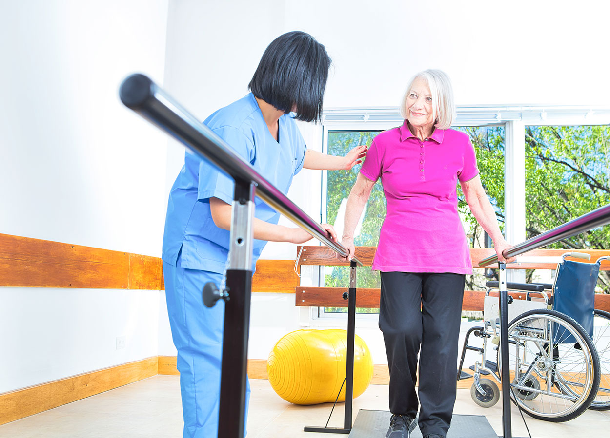 Nurse Helping a Lady Exercise